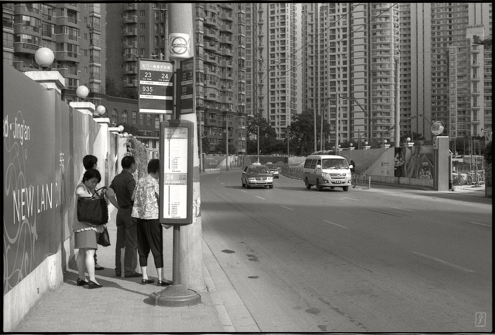 A bus stop and a backdrop of new appartments near the intersection Shimen yilu/Nanjing xilu in the heart of the city.